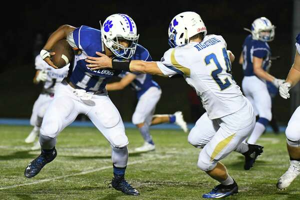 Bunnell receiver-turned-Wildcat quarterback Zhyaire Fernandes (11) rushed for four touchdown and passed for another, all in the first half, in a 35-34 loss to Newtown last Friday.