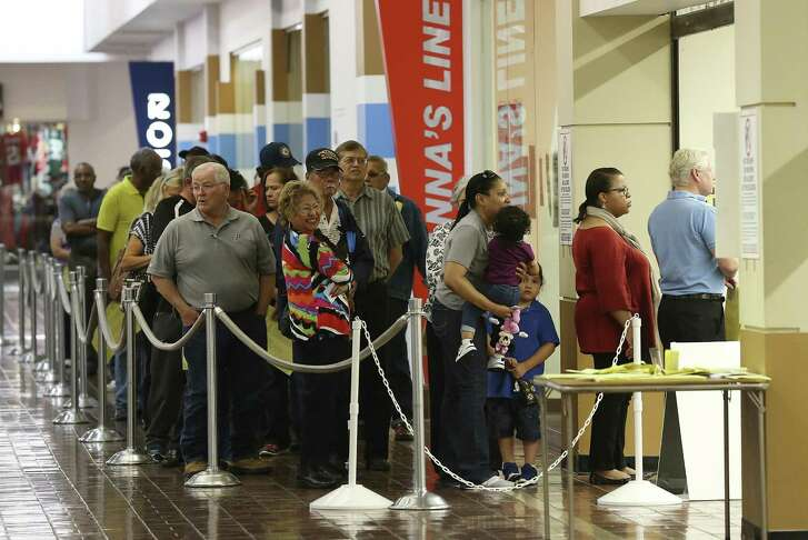 A line forms as people cue up to vote at the Wonderland of the Americas Mall, Tuesday, Oct. 25, 2016. Lines were visible at some of the sites on the second day of early voting that started Monday and will run through Friday November 4th. According to people leaving after casting their vote, a 45-minute wait was the average.