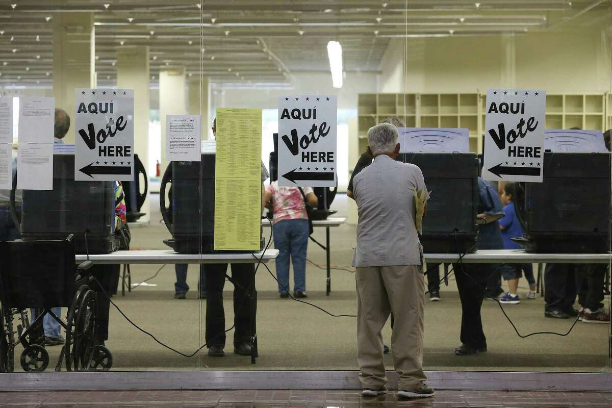 A man checks out the polling location at the Wonderland of the Americas Mall in San Antonio on Tuesday, the second day of early voting.