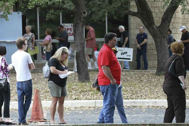 A line forms as people cue up to vote at the Brook Hollow Library, Tuesday, Oct. 25, 2016. Lines were visible at some of the sites on the second day of early voting that started Monday and will run through Friday November 4th. According to people leaving after casting their vote, a 45-minute wait was the average.