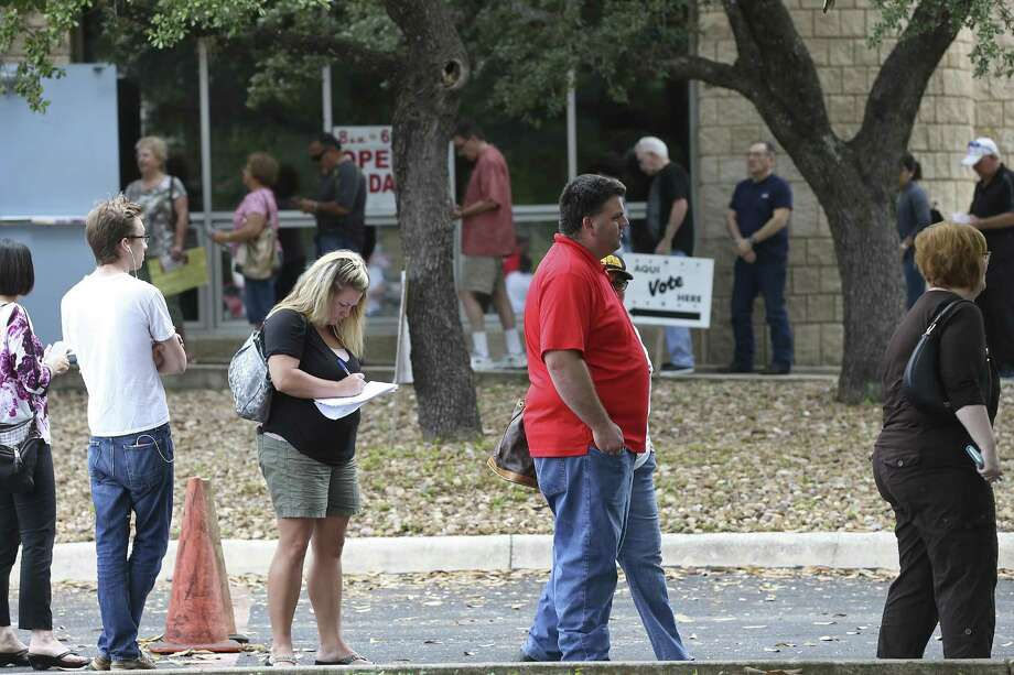 A line forms as people cue up to vote at the Brook Hollow Library in San Antonio, Tuesday, Oct. 25, 2016. Lines were visible at some of the sites on the second day of early voting that started Monday and will run through Friday November 4th. According to people leaving after casting their vote, a 45-minute wait was the average. Photo: Jerry Lara, Staff / San Antonio Express-News / © 2016 San Antonio Express-News