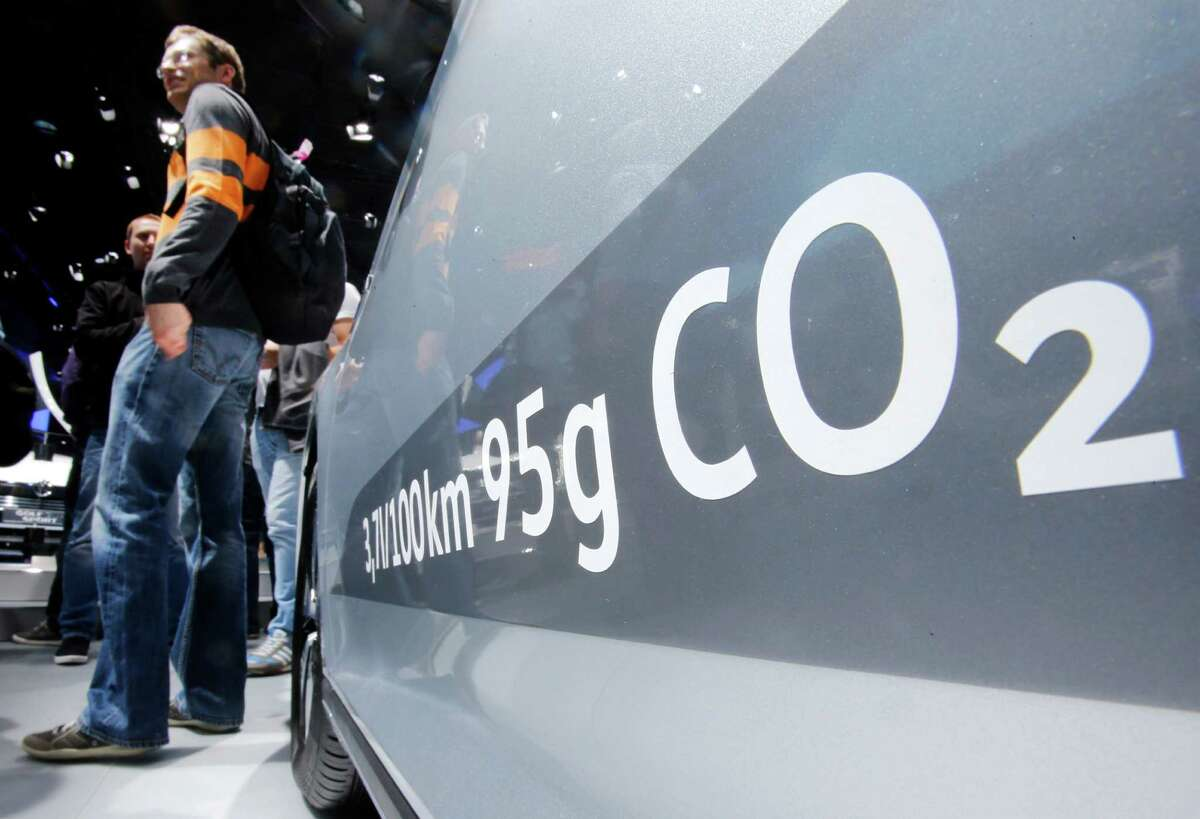 FILE - In this Sept. 22, 2015, file photo, the amount of carbon dioxide emissions is written on a Volkswagen Passat Diesel at the Frankfurt Car Show in Frankfurt, Germany. A federal judge in San Francisco is facing a deadline on whether to approve a nearly $15 billion deal over Volkswagen's emissions cheating scandal that gives most affected car owners the option of having the company buy back their vehicles. U.S. District Judge Charles Breyer said at a hearing last week that he was strongly inclined to give the deal final approval and would issue a ruling by Tuesday, Oct. 25, 2016. (AP Photo/Michael Probst, File)