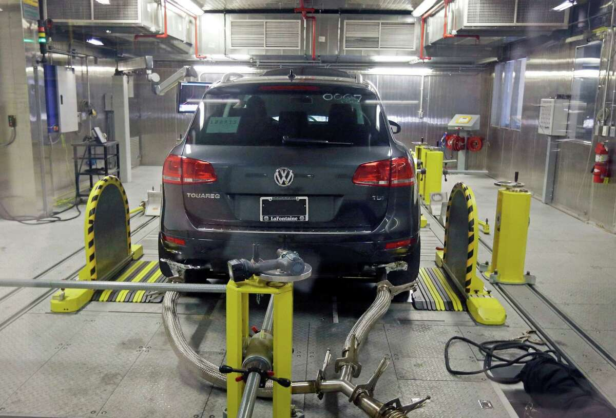 A Volkswagen Touareg diesel is tested last year in an Environmental Protection Agency facility in Ann Arbor, Mich.