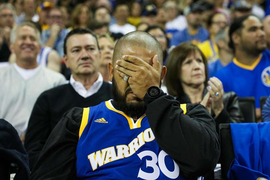 Ben Sanchez covers his eyes after Warriors lose control of the ball first half of a first quarter game between the Warriors vs. the Spurs, at Oracle Arena, in Oakland, California, on Tuesday, Oct. 25, 2016.