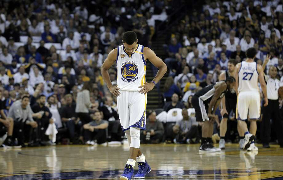 Stephen Curry (30) walks back up court in the first half as the Golden State Warriors played the San Antonio Spurs in their season opener at Oracle Arena in Oakland, Calif., on Tuesday, October 25, 2016. Photo: Carlos Avila Gonzalez, The Chronicle