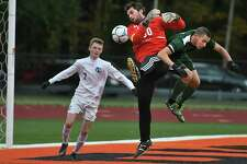 Ichabod Crane goalkeeper Peter Volkmann battles for the ball in a corner kick with Schalmont's Andrew Masullo during the Class B boys' soccer semifinals on Tuesday, Oct. 25, 2016 in Rotterdam, N.Y. Ichabod Crane's Kevin Winglosky is seen at left. (Lori Van Buren / Times Union)