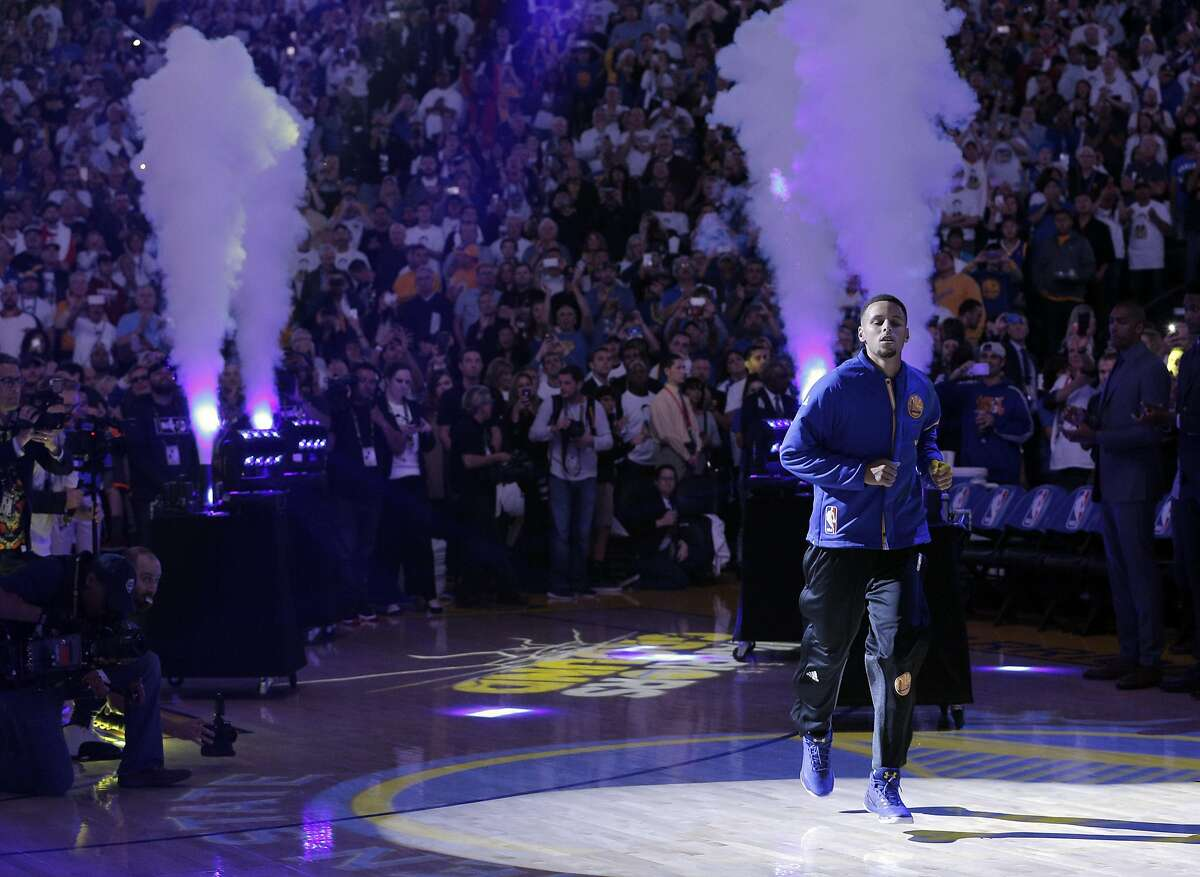 Stephen Curry (30) is introduced before the game as the Golden State Warriors played the San Antonio Spurs in their season opener at Oracle Arena in Oakland, Calif., on Tuesday, October 25, 2016.