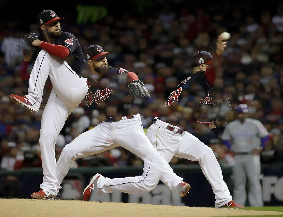 In this multiple exposure picture, Cleveland Indians starting pitcher Corey Kluber throws against the Chicago Cubs during the third inning of Game 1 of the Major League Baseball World Series Tuesday, Oct. 25, 2016, in Cleveland. (AP Photo/Matt Slocum)