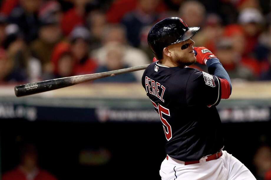 CLEVELAND, OH - OCTOBER 25:  Roberto Perez #55 of the Cleveland Indians hits a three-run home run during the eighth inning against the Chicago Cubs in Game One of the 2016 World Series at Progressive Field on October 25, 2016 in Cleveland, Ohio.  (Photo by Elsa/Getty Images) ORG XMIT: 678125457 Photo: Elsa / 2016 Getty Images