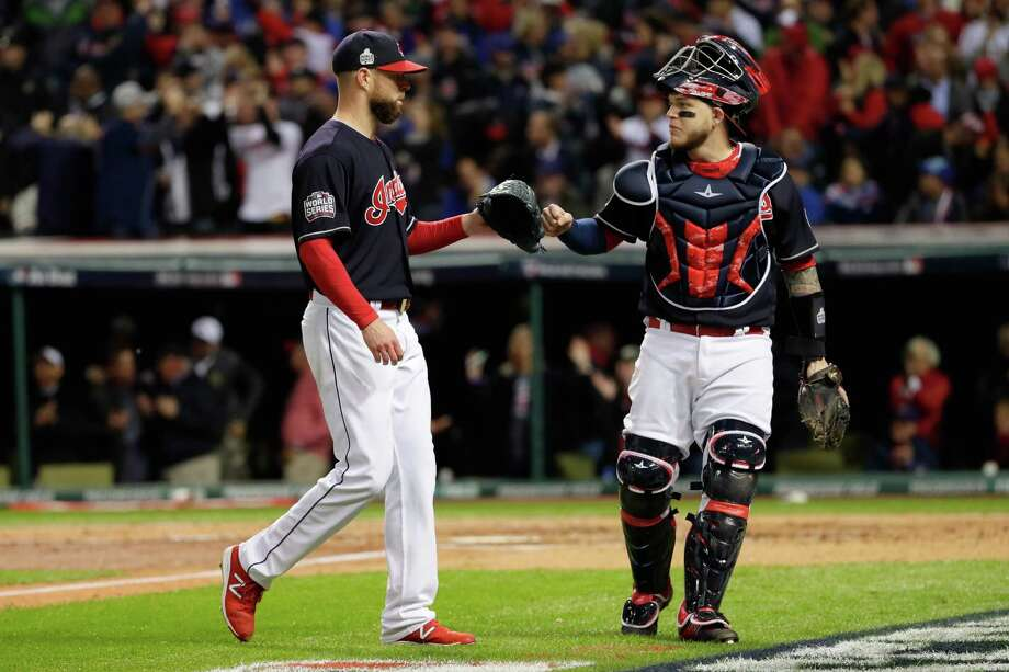 CLEVELAND, OH - OCTOBER 25:  Corey Kluber #28 and Roberto Perez #55 of the Cleveland Indians react after the second inning against the Chicago Cubs in Game One of the 2016 World Series at Progressive Field on October 25, 2016 in Cleveland, Ohio.  (Photo by Jamie Squire/Getty Images) Photo: Jamie Squire, Staff / 2016 Getty Images