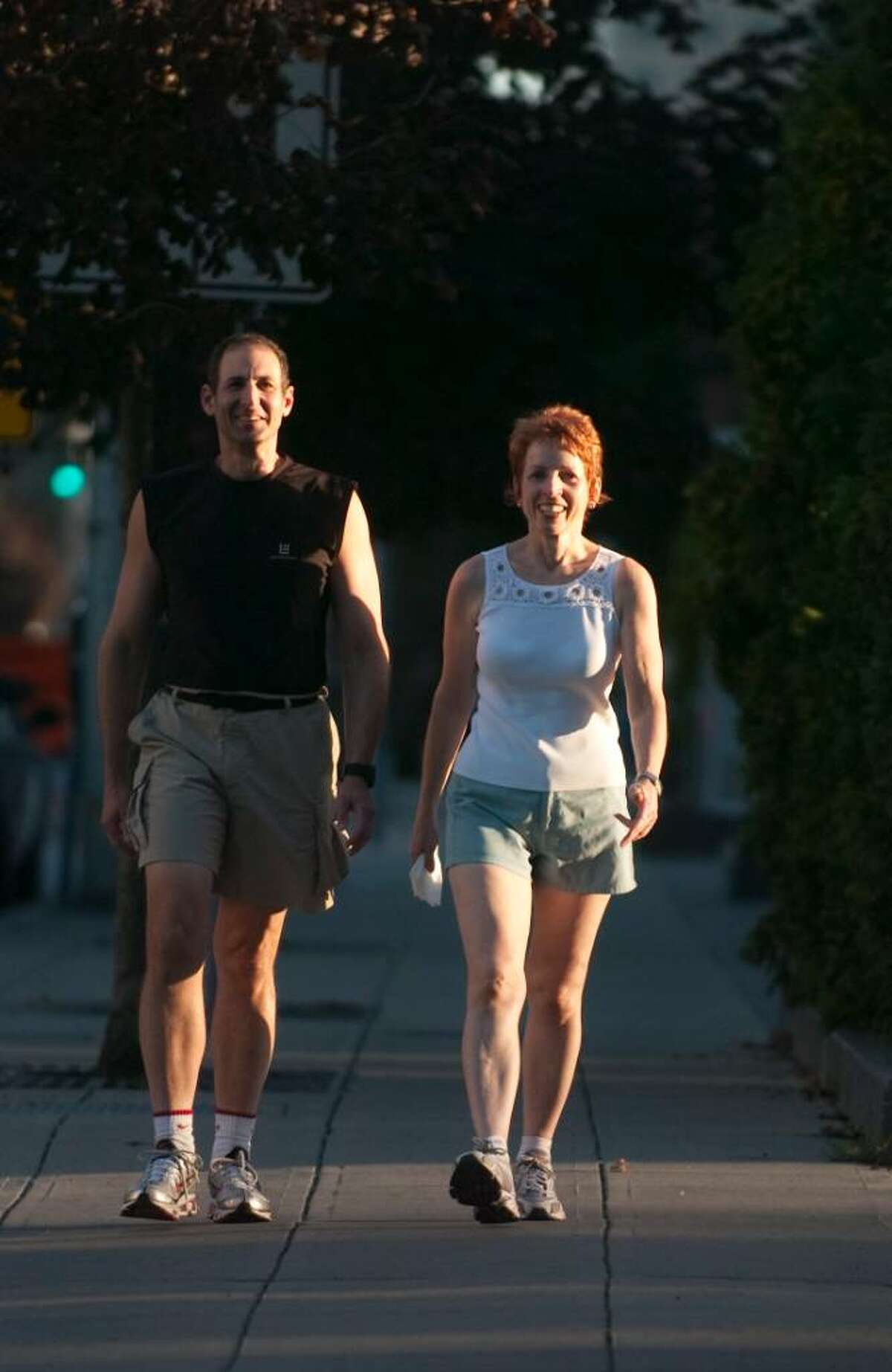 Myles Cohen, 58, and his wife Mary, 55, walk their usual route in downtown Stamford on Tuesday, September 1, 2009.