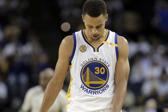 Stephen Curry (30) walks back up court after a call went against the Warriors in the second half as the Golden State Warriors played the San Antonio Spurs in their season opener at Oracle Arena in Oakland, Calif., on Tuesday, October 25, 2016.