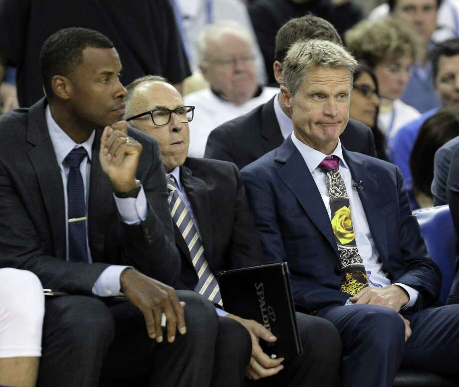 Warriors head coach Steve Kerr, right, and assistant coaches Ron Adams, center, and Jarron Collins, left, sit on the bench as the Spurs pull further away in the second half as the Golden State Warriors played the San Antonio Spurs in their season opener at Oracle Arena in Oakland, Calif., on Tuesday, October 25, 2016. Photo: Carlos Avila Gonzalez, The Chronicle / Carlos Avila Gonzalez - San Francisco Chronicle
