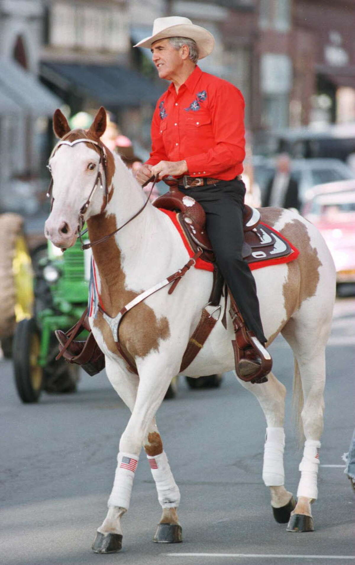 Senator Joseph L. Bruno rides his horse, Apache, in the Saratoga County Fair opening day parade on July 23, 1996.