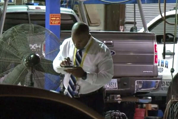 An auto shop worker died Tuesday night after a pickup truck fell off the lift at Reliable Auto Services in northwest Houston, authorities said.