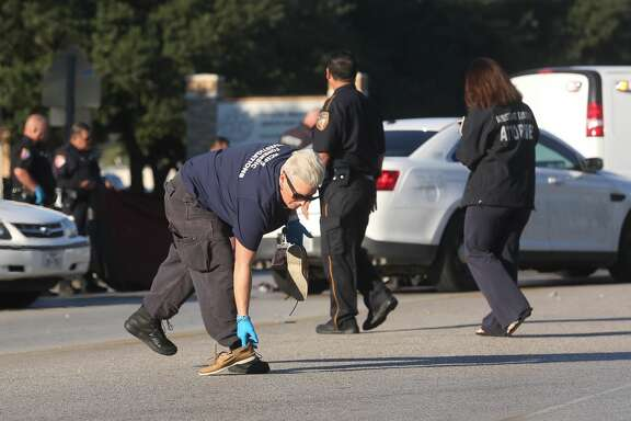 Authorities investigate the scene of an accident that killed a student in front of MacArthur High School Wednesday, Oct. 26, 2016, in Houston.