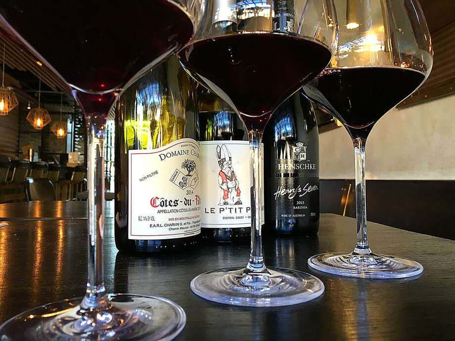 """A flight of red wines at High Street Wine Co. From left: Domaine Charvin Cotes du Rhone from France, Le P'Tit Paysan from California and Hentschke """"Henry's 7"""" from Australia. Photo: Mike Sutter /San Antonio Express-News"""