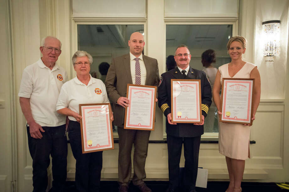 Photo provided Carl and Esther Gerstacker Police and Firefighter of the Year honorees include, from left, Larkin Township Firefighters Earl and Kay Rinas, Midland County Sheriff's Office Corrections Deputy Adam Wright, Midland Fire Department Assistant Chief Greg Weisbarth and Midland Police Detective Tonya Laubscher. / 2016