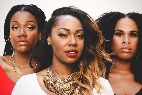 Twins Paris, center, and Amber Strother, left, and musical sister Anita Bias are KING.