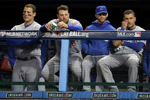 CLEVELAND, OH - OCTOBER 25:  Anthony Rizzo #44 of the Chicago Cubs (L) and Ben Zobrist #18 (C) look on from the dugout during Game One of the 2016 World Series against the Cleveland Indians at Progressive Field on October 25, 2016 in Cleveland, Ohio.