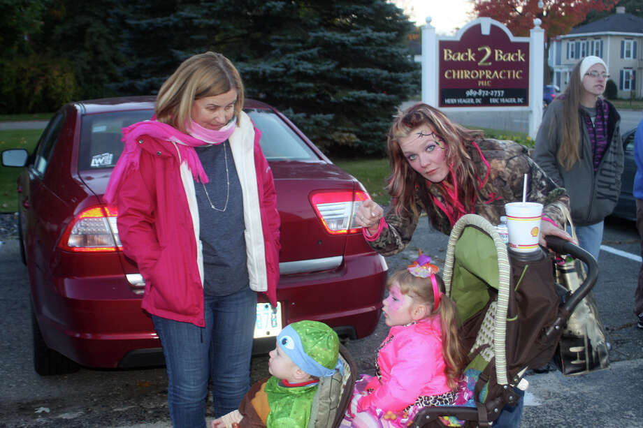 Folks of all ages came out Tuesday for Pink-Or-Treat in Cass City. Photo: Brenda Battel/Huron Daily Tribune