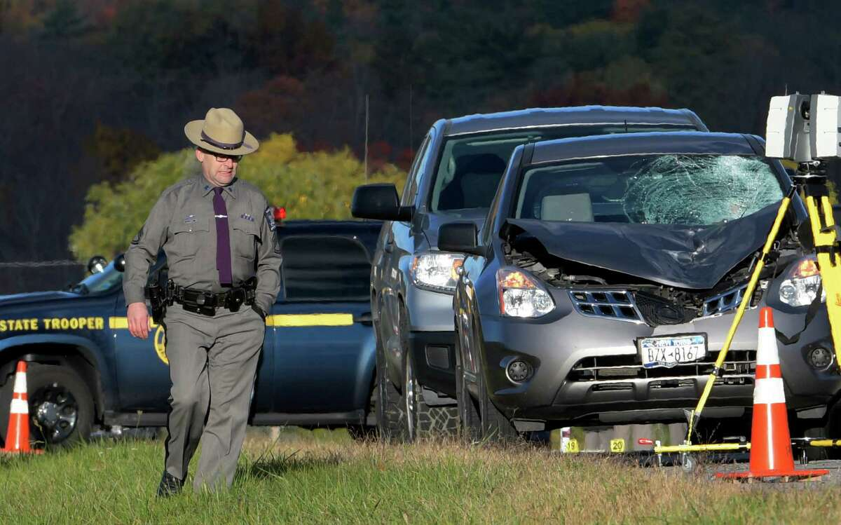 Investigators from the New York State Police begin the task of determining the cause of accident that took the life of Trooper Tim Pratt early Wednesday morning Oct. 26, 2016 on Ballard Road in Wilton, N.Y. (Skip Dickstein/Times Union)