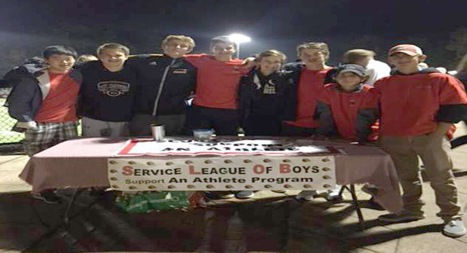 p.p1 {margin: 0.0px 0.0px 0.0px 0.0px; font: 13.0px Verdana; -webkit-text-stroke: #000000} span.s1 {font-kerning: none}Service League of Boys members collected donations at a recent Friday night New Canaan Rams' football game to benefit fellow athletes in Bridgeport. Photo: Submitted By Alma Cortina