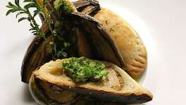 Boar empanadas with chimichurri and roasted vegetables.