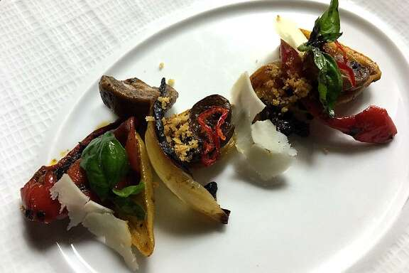 An antipasto dish with marinated mushrooms and peppers with calda Espana cheese from Restaurant Gwendolyn, chef Michael Sohocki's pre-industrial project above the River Walk in San Antonio. 10/25/16
