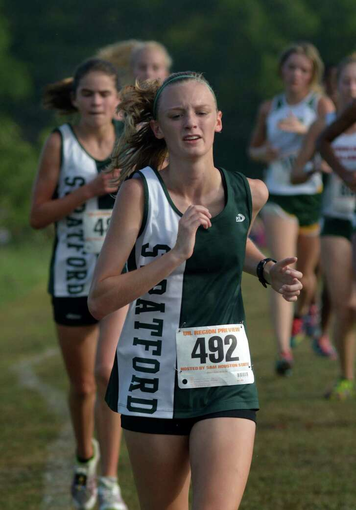 Stratford junior Sydney Lawrence (492) competes in the Varsity Girls Elite 5000 Meter race at the UIL Region III Cross Country Meet at Kate Barr-Ross Park in Huntsville on Sept. 10, 2016. (Photo by Jerry Baker/Freelance)