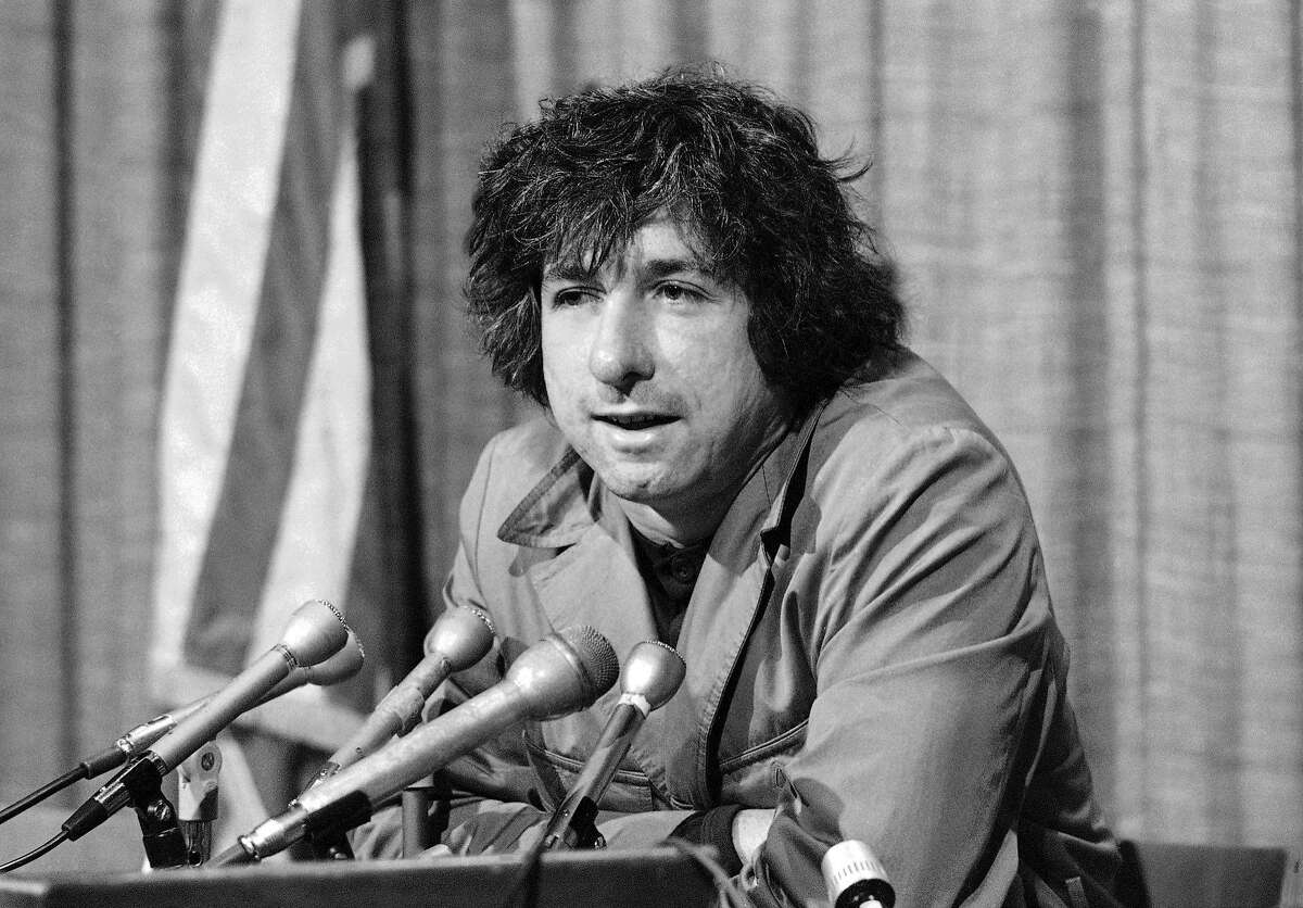 In this 1973 file photo, political activist Tom Hayden tells the press in Los Angeles that he believes public support was partially responsible for the decision not to send him and others of the Chicago 7 to jail for contempt.