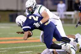 Quarterback Brady McConaty (2) of Westbury Christian is tackled by Fort Bend Christian's Jared McDonald (76) last weekend.