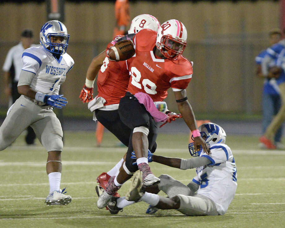 Robert Atlee (20) of Bellaire leaps past a Westbury defender on a kickoff return at the start of the third quarter of a high school football game between the Bellaire Cardinals and the Westbury Huskies on Thursday October 20, 2016 at Butler Stadium, Houston, TX. Photo: Craig Moseley, Staff / ©2016 Houston Chronicle