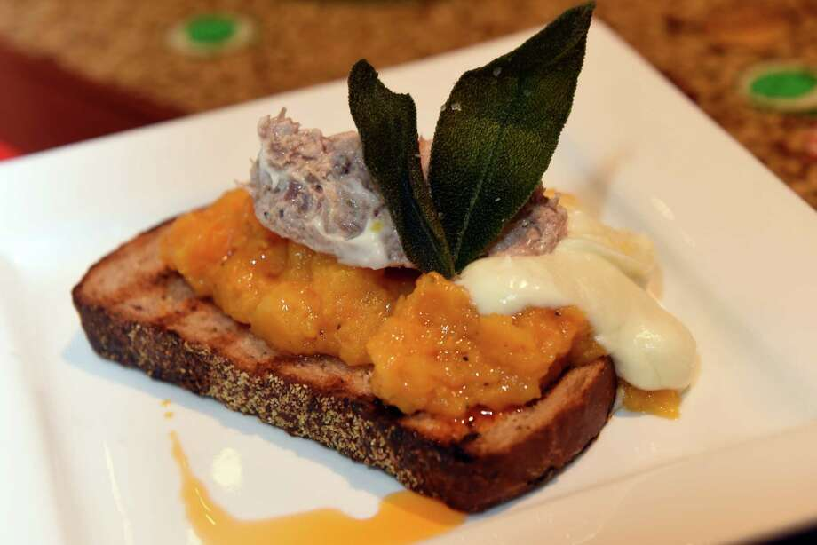 First course duck rillettes on a butternut squash bruschetta with cinnamon crostini,, sage and chvre bŽchamel during a beer pairing dinner with Garrett Oliver of Brooklyn Brewery at The Ruck on Tuesday Oct. 18, 2016 in Troy , N.Y.  (Michael P. Farrell/Times Union) Photo: Michael P. Farrell / 20038423A