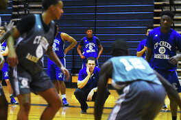 Cy Creek Basketball head coach Dan Trocquet observes drills at practice earlier this week. Creek did not lose much talent to graduation and projects to take another step forward this season, which could very well mean a playoff berth.