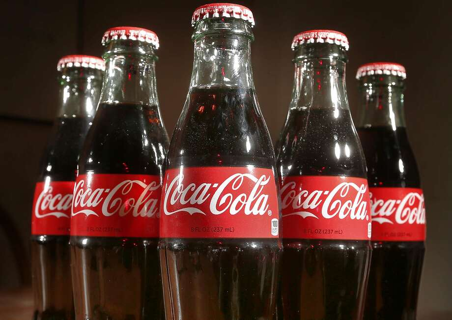 Improbable robber disguise: a Coke bottle. Photo: Jim Cole, Associated Press