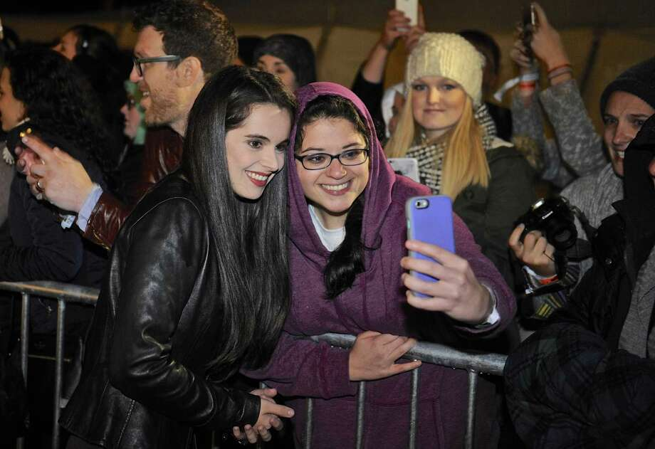 """Gilmore Girls"" tv show cast member Vanessa Marano, who plays ""April"", takes a photo with Brianna Williams, of Monroe, as she arrives at Bryan Memorial Town Hall for a cast pannel discussion during the Gilmore Girls Fan Fest in Washington Depot, Conn, on Saturday, October 22, 2016. Photo: H John Voorhees III / Hearst Connecticut Media / The News-Times"