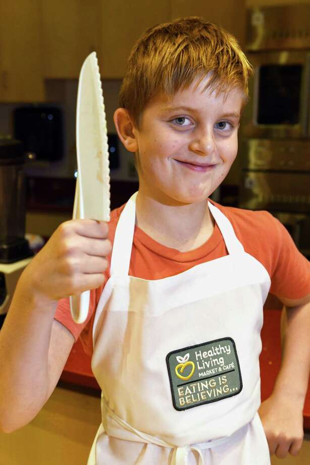 Eight-year old culinary instructor Johnno Huss of Saratoga Springs poses with a plastic chef's knife in the Healthy Living Market kitchen Friday Oct. 21, 2016 in Saratoga Springs, NY.  (John Carl D'Annibale / Times Union) Photo: John Carl D'Annibale / 20038479A