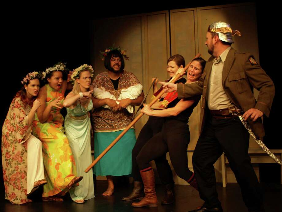 The Women of Greece defend the Acropolis, where they have taken control of the Athenian Treasury, in Lysistrata.  From Left: Lysistrata played by Suzanna Bornn, Kalonike played by Monica Hoh, Myrhinne (in white) is played by Sarah Malone, the Boeotian Woman played by Mike Lake, -- The Guards are: Alexandra Doggette and Jenae Halsted; far Right is the Commissioner played by Travis Fealy.