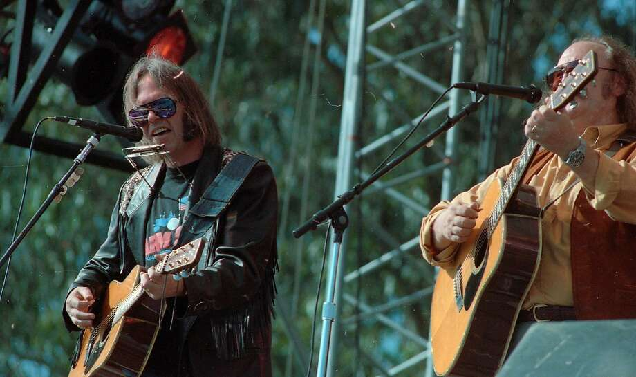Neil Young and David Crosby at the Laughter, Love & Music concert in memory of Bill Graham on November 3, 1991. Photo: Brant Ward, The Chronicle