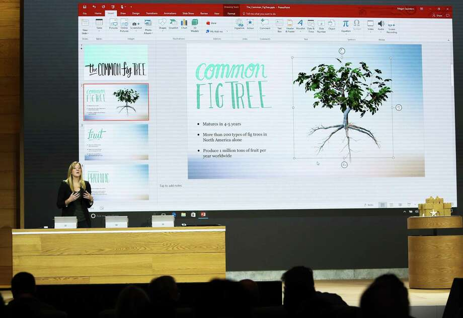 Heather Alekson, with the experience design team at Microsoft, demonstrates the 3-D capabilities added to Windows 10 in a PowerPoint presentation Wednesday in New York. Photo: Microsoft / FR170720 AP
