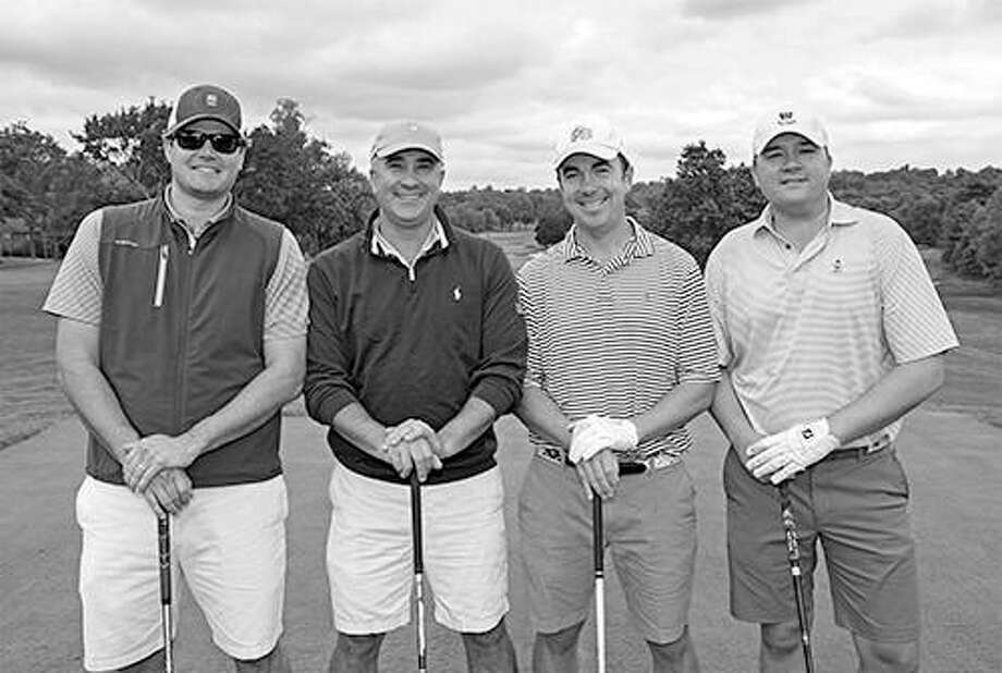 Ethan Bing (second from left) and Steven Haberstroh (right), both of New Canaan, were in one of the winning foursomes during The Maritime Aquarium at Norwalks 6th annual Maritime Golf Classic on Oct. 3 at Wee Burn Country Club. One hundred area business professionals raised $154,000 to support the Aquariums environmental-education programming. Also in the foursome were Patrick Kiely (left) of Rowayton and Michael Ker (third from left) of Greenwich. Learn more about the Aquariums educational programs, exhibits, IMAX movies and more this fall at www.maritimeaquarium.org. Photo: Kristen Jensen / Contributed Photo / New Canaan News contributed