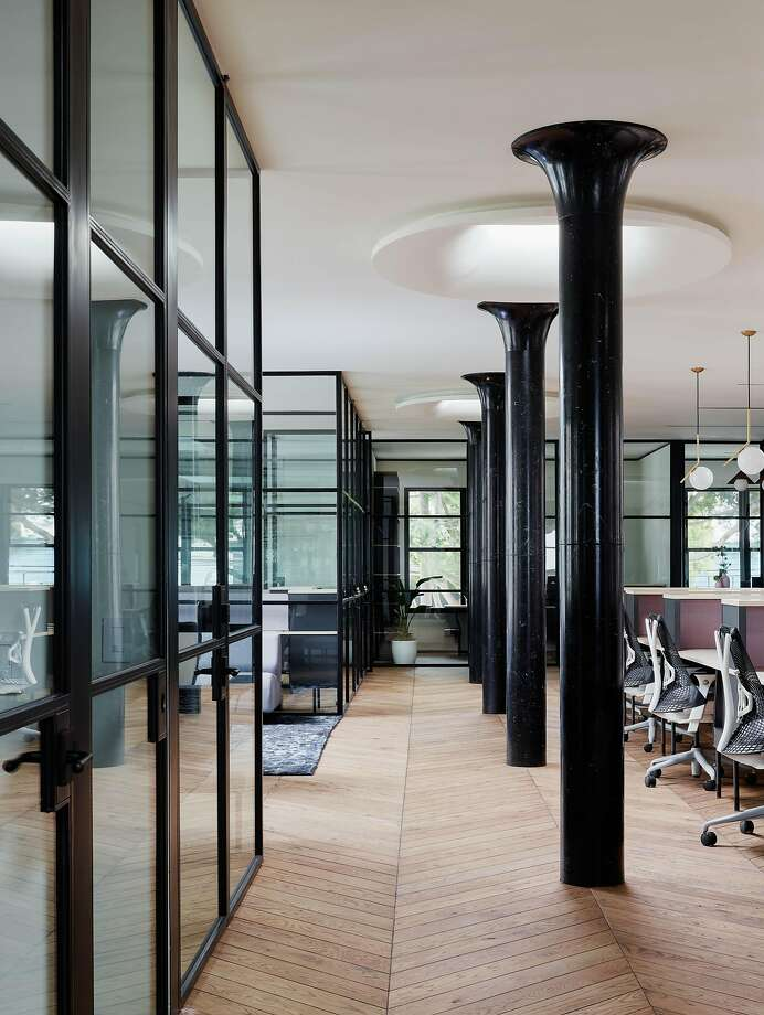 "Glass offices: ""The main feature you see when you walk in is black steel, horizontal line of glass,"" Behar says. ""The space still looks like it has light, but there are individual offices, including the conference rooms. So it feels airy, even though it's broken up into seven rooms, five private offices and two conference rooms."" Photo: Joe Fletcher"