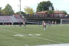 The New Canaan and Darien field hockey teams square off in a regular season game on Wednesday, Sept. 24, 2014 at Dunning Stadium.