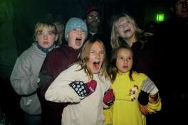 "Freaking out at ""Fright Fest"", at the Great Escape Amusement Park.  The girls were scared while watching a mad scientist tying to bring a monster back to life. (Great Escape photo)"