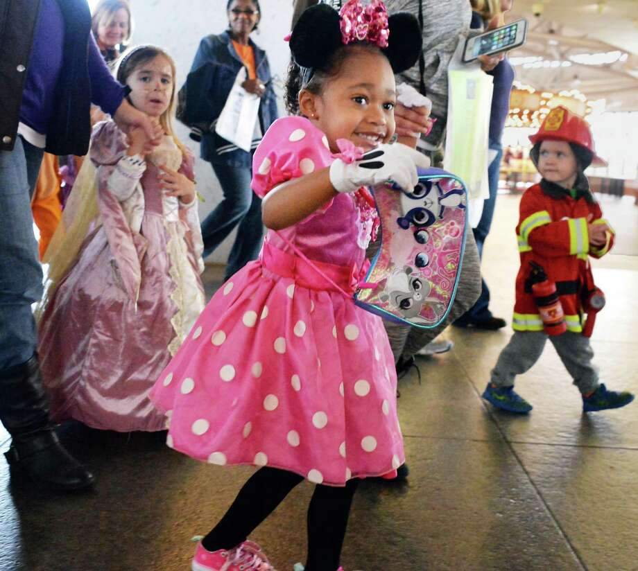 Dressed as Minnie Mouse, 4-year-old Maya Hanczaryk of Troy marches in the costume parade at the Monster Mash and Bash at the New York State Museum Saturday Oct. 24, 2015 in Albany, NY.  (John Carl D'Annibale / Times Union) Photo: John Carl D'Annibale / 10033902A