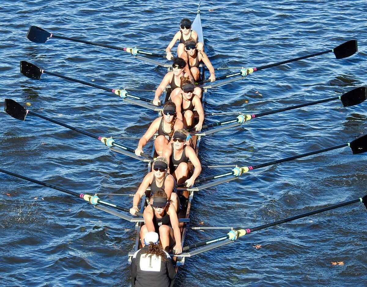 The Saugatuck Rowing Club women?'s youth 8+ crew powering to a win at the Head of the Charles Regatta. Caitlin Esse of New Canaan is third from the front (counting down from top of photo).