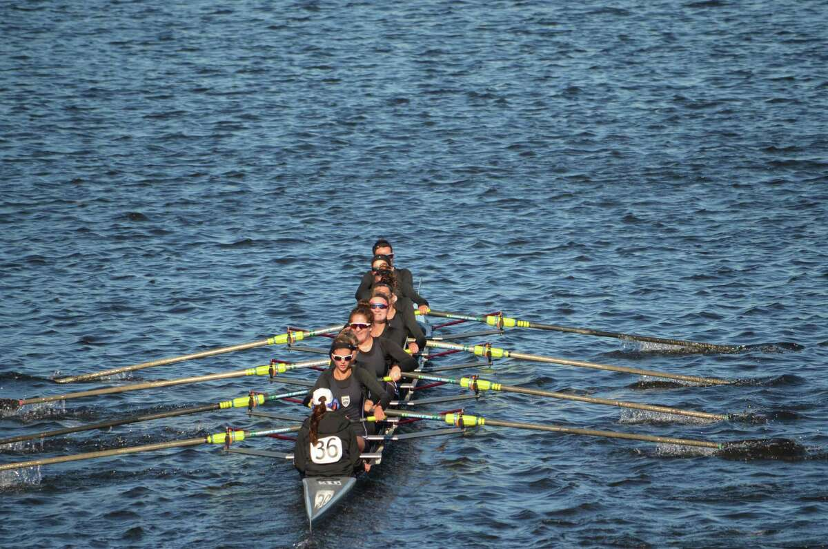 Saugatuck Rowing Club?'s second varsity 8+ competing in the women?'s youth 8+ event in the Head of the Charles Regatta. Sydney Kend of New Canaan rows in 6 seat, counting backward from the front of the boat (top of the photo).