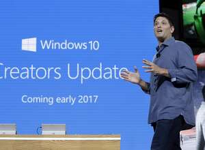 """Terry Myerson, Microsoft's executive vice president of the Windows and Devices Group, discusses a Windows 10 update at a Microsoft media event in New York, Wednesday, Oct. 26, 2016. The new tools, part of a free """"Creators Update"""" to Windows 10 early next year, promises to make it easy for people to create and share photos, drawing and other images in 3-D. (AP Photo/Richard Drew)"""