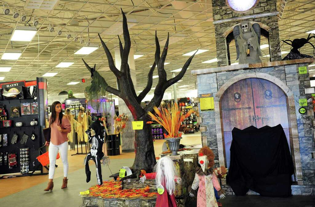 mariana pinheiro of bridgeport walks past one of the displays while shopping at spirit spirit halloween store - Spirit Halloween Store 2016